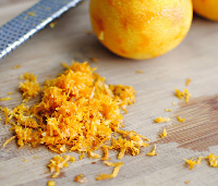 scraping or cutting away the outer skin of citrus fruit gives you zest