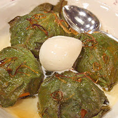 Apricots wrapped in fig leaves, baked and served with ice cream